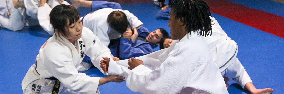 People practicing judo.